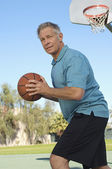 Senior Man Playing Basketball — 图库照片