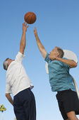 Men Playing Basketball Against Blue Sky — Stock Photo