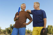 Male Friends Holding Baseball Bat And Mitt — Stock Photo