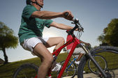 Two Multiethnic Friends Riding Bicycles — Stock Photo