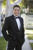 Young Man In Tuxedo Standing With Hands In Pocket At Quinceanera — Stock Photo