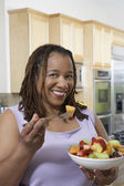 Obese Woman Having Fruit Salad — Stock Photo