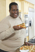 Man Holding Slice Of Pizza — Stock Photo