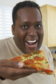Man Eating Slice Of Pizza — Stock Photo