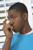 Young Boy Using Asthma Inhaler — Stock Photo