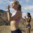 Female Joggers Drinking Water Outdoors — Stok fotoğraf