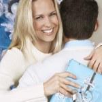 Woman With Christmas Present Hugging Man — Stock Photo