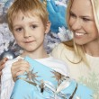 Beautiful Woman With Son Holding Christmas Present — Foto de Stock