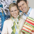 Couple Standing Together With Christmas Gifts — Stock Photo