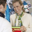 Female Receiving Christmas Gift From Man — Stock Photo