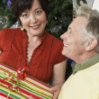 Happy Couple Holding Gift - Stock Photo
