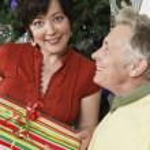 Happy Couple Holding Gift — Stock Photo