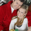 Couple Holding Present Embracing - Stock Photo