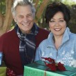 Multiethnic Couple With Gift Boxes Outdoors — Stock Photo