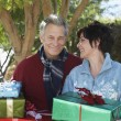 Couple Holding Gift Boxes Outdoors — Stock Photo