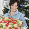 Happy Woman Holding Gift Box — Stock Photo