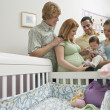 Two Couples And Baby By Cradle — Stock Photo
