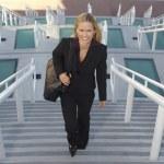 Businesswoman Walking Up Stairs — Stock Photo