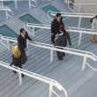Stock Photo: Businesspeople Moving Up And Down Stairs