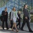 Stock Photo: Businesspeople Walking Past Office Building