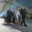 Businesspeople Walking Past Office Building — Stock Photo