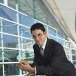 Stock Photo: Confident BusinessmLeaning On Railing