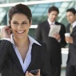 Businesswoman Using Cell Phone Outside Office — Stock Photo #21953587
