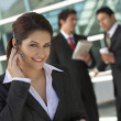 Businesswoman Using Cell Phone Outside Office — Stock Photo #21953601