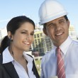 Businessman Showing Clipboard To Businesswoman With Earpiece — Stock Photo