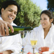 Chinese Couple Wearing Bathrobes Drinking Champagne — Stock Photo