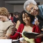 Senior Teacher And Students In Classroom — Stock Photo