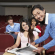 Stock Photo: Happy Students With Teacher In Classroom