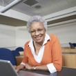 Senior Teacher Using Laptop At Desk — Stock Photo