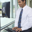 Business Man Using Internet On Computer — Stockfoto
