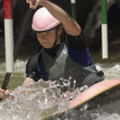 Young Woman Whitewater Kayaking - Foto Stock