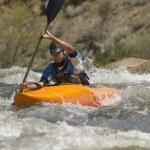 Young Man Kayaking — Stock Photo #21956099