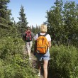 Couple Walking Along Trail In Forest — Stock Photo