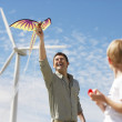 Father And Son Playing With Kite At Wind Farm — Stock Photo
