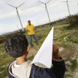 Father And Son Playing At Wind Farm — Stock Photo