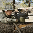 Stock Photo: Soldier With Machine Gun Leaning On Log