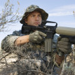 Stock Photo: Soldier Aiming Machine Gun