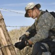 Soldier Cutting Barbed Wire Fence — Stock Photo