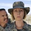 Stock Photo: Female Soldier and commander