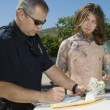 Stock Photo: Officer Making Drug Bust