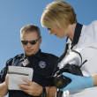 Police Officer And Investigator With Camera — Stock Photo