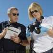 Police Officer And Investigator With Camera - Stock Photo