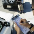 Foto de Stock  : Police Officer Writing Ticket