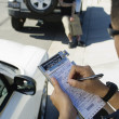 Stock Photo: Police Officer Writing Ticket
