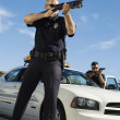 Police Officer Aiming Shotgun — Stock Photo