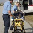 Paramedics Carrying Victim On Stretcher - Zdjęcie stockowe